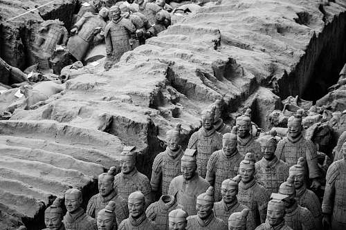 black-and-white human statues soil