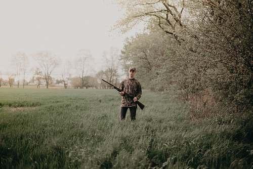 person man holding gun military