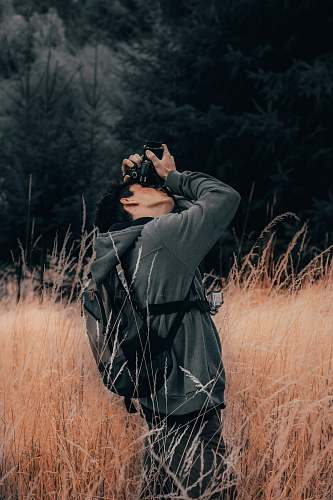 photo person man taking photo using DSLR camera outdoor photographer free for commercial use images