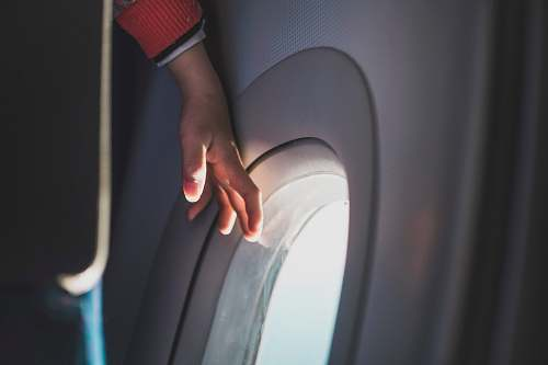 photo person person touching airplane window hand free for commercial use images