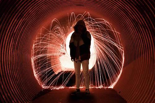 photo person person wearing hood standing in tunnel lighting free for commercial use images