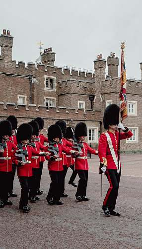 person royal guards parading near building during day military