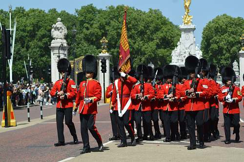 person royal guards walking near people military