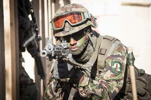 person soldier holding assault rifle people