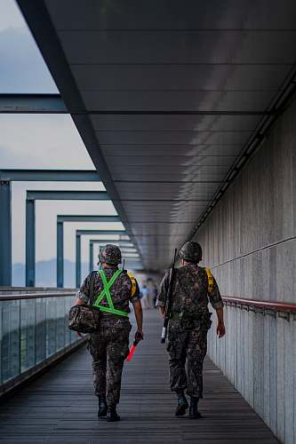 person two soldier men walking on pathway military