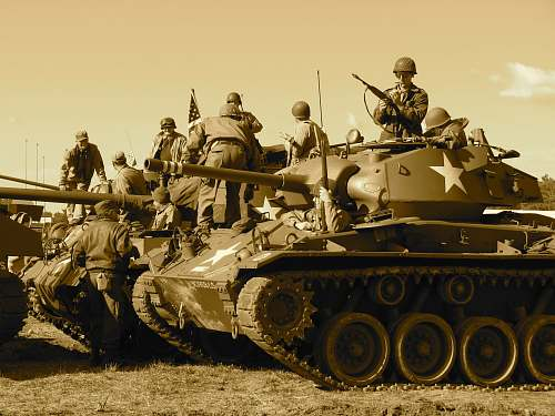 tank people sitting and standing on battle tank army