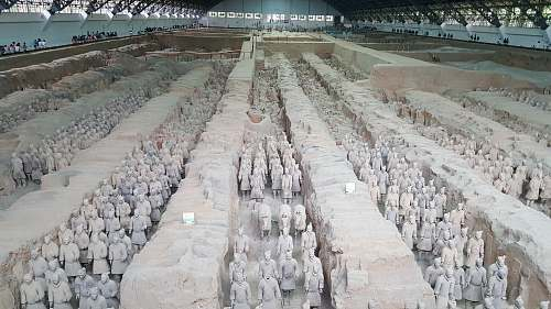 grey terracotta soldiers inside warehouse military uniform