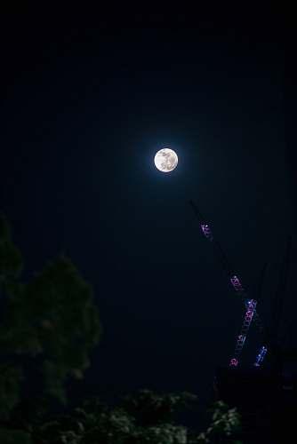 outdoors black and purple pendant lamp moon