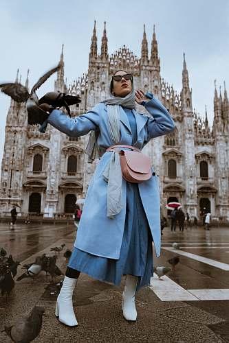 human woman near pigeons person