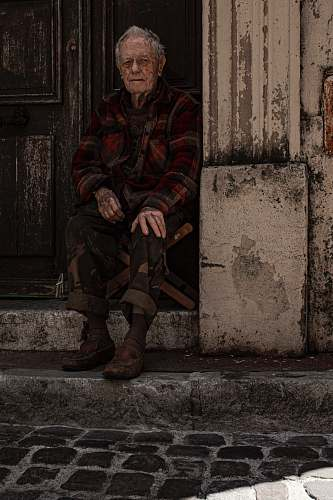 human man sitting on folding chair beside door military