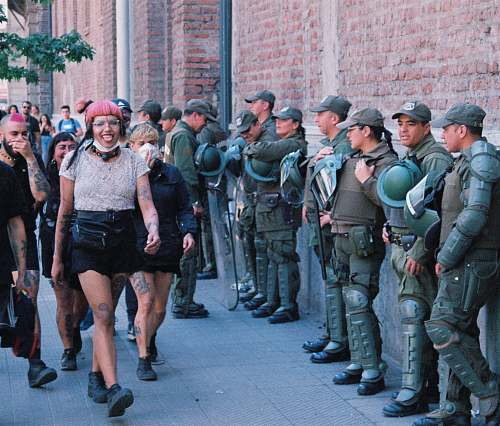 human people walking in front of officers on street apparel