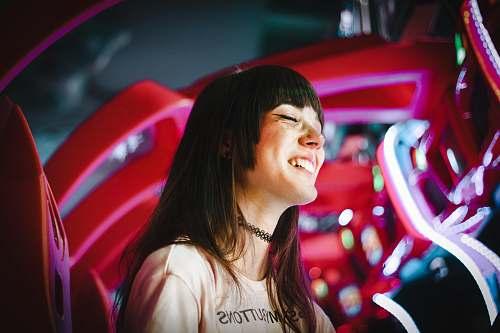 people photo of smiling woman wearing black choker human