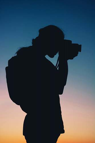 human silhouette of person using camera photography