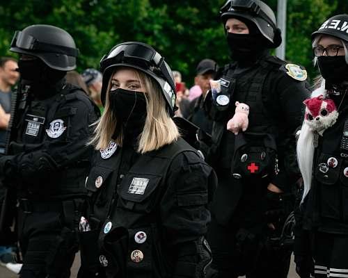 human woman in black uniform police