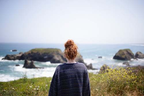 human woman looking at body of water people