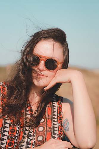 people woman wearing sunglasses and orange shirt human