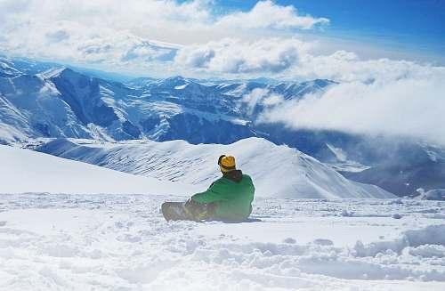 sport man snowboarding on snow during daytime snowboarding