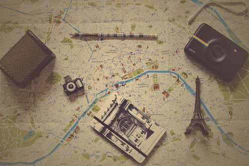 map black camera near gray metal Eiffel tower figurine travel