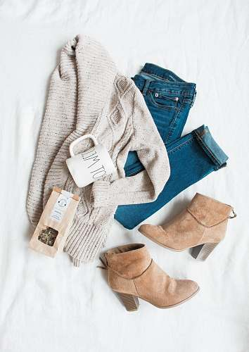 clothes gray cardigan, blue jeans, and pair of brown chunky heeled shoes clothing