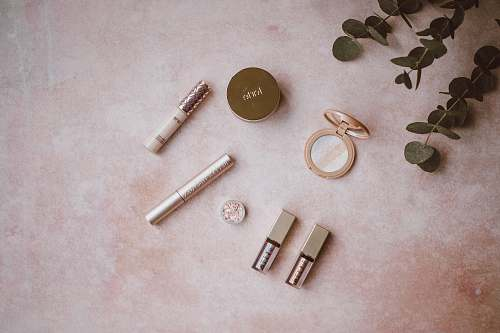 makeup assorted makeup kit set on gray surface beauty
