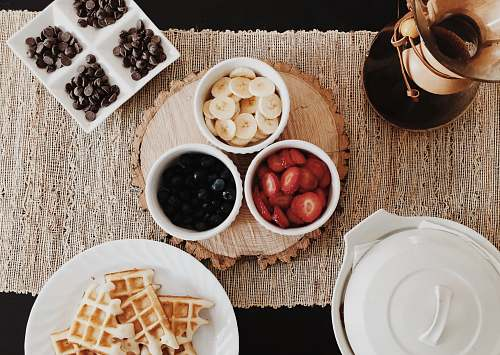 breakfast foods on cups and saucers waffle