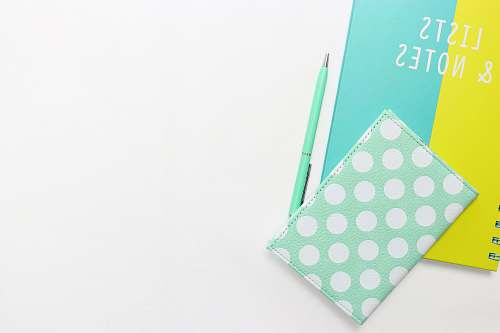 blue teal and white polka-dot wallet on table learning language