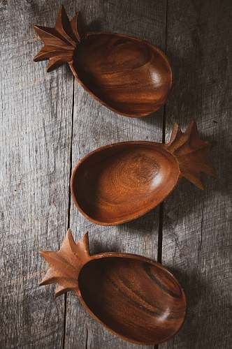 spoon three brown wooden bowls on gray wood cutlery