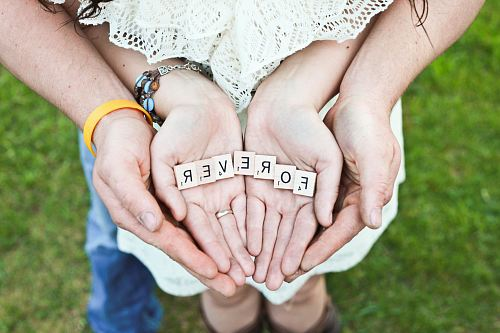 photo adult and girl holding forever scrabble letters during daytime free for commercial use images
