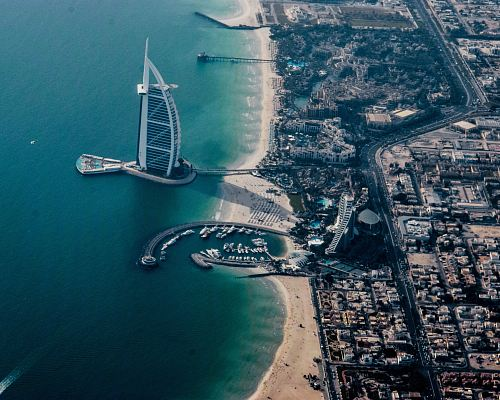 aerial photography of Burj Al-Arab near seashore