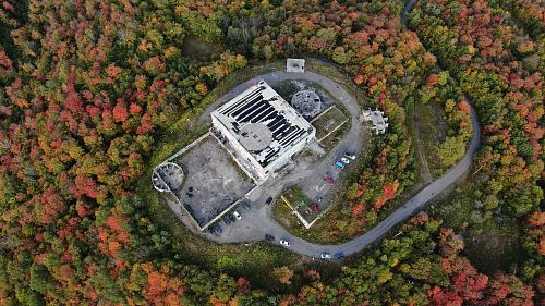 photo aerial photography of white concrete building surrounded by trees free for commercial use images