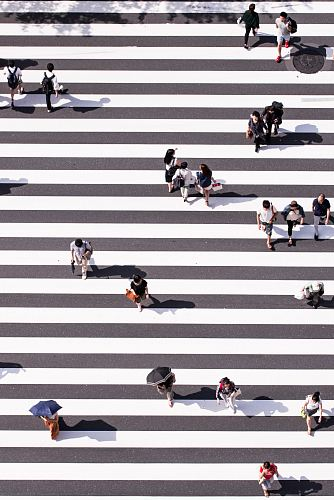 photo aerial view photography of group of people walking on gray and white pedestrian lane free for commercial use images