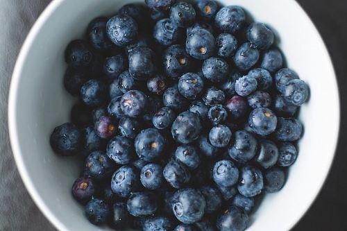 blueberries on white ceramic plate