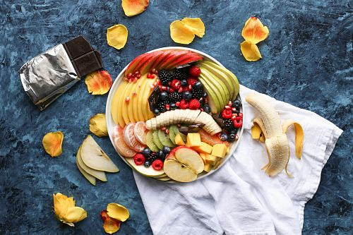 photo bowl of sliced fruits on white textile free for commercial use images