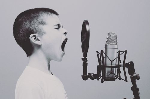 photo boy singing on microphone with pop filter free for commercial use images