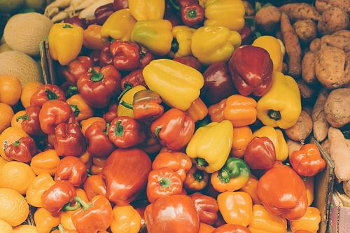 photo flat lay photography of bunch of yellow and red bell peppers free for commercial use images