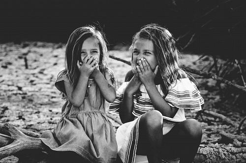 photo grayscale photography of two girls closing their mouths free for commercial use images