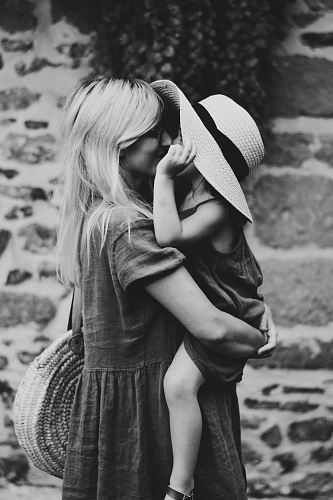 photo grayscale photography of woman carrying girl free for commercial use images