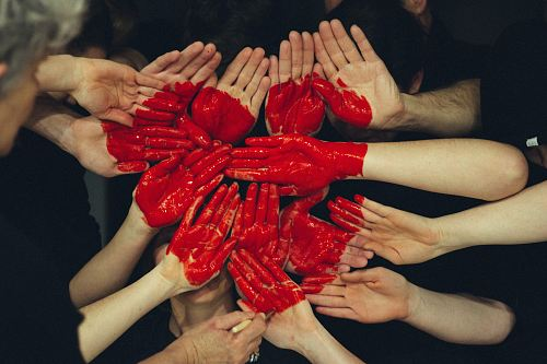 photo hands formed together with red heart paint free for commercial use images