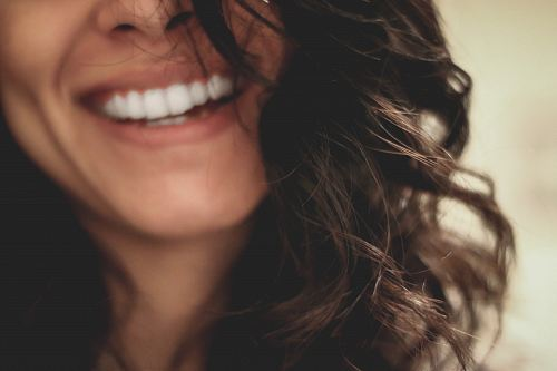 photo long black haired woman smiling close-up photography free for commercial use images