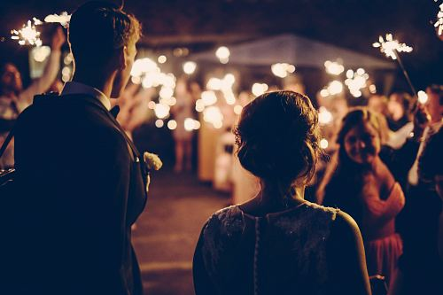 photo man standing near the woman walking in party during nighttime free for commercial use images