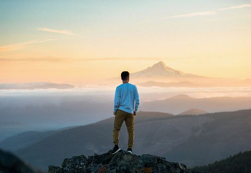 photo man standing on top of mountain free for commercial use images