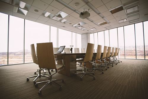 photo oval brown wooden conference table and chairs inside conference room free for commercial use images