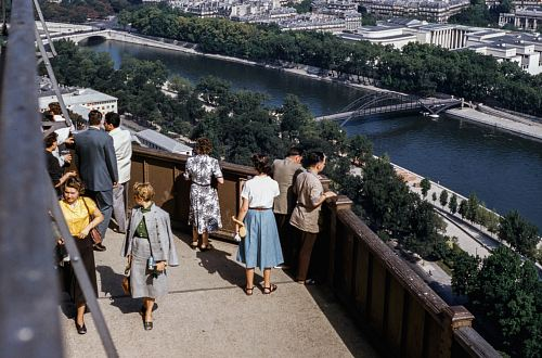 people standing on terrace with view of river