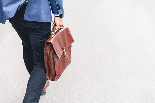 photo person walking holding brown leather bag free for commercial use images