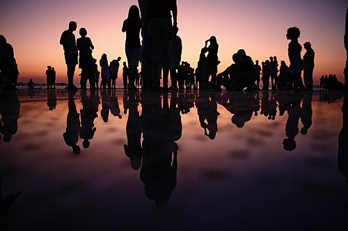 photo silhouette of people standing on mirror during golden hour free for commercial use images
