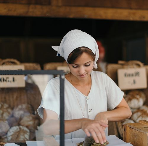photo woman slicing bread free for commercial use images