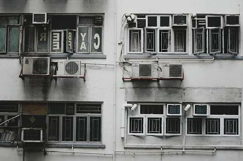 photo hong kong white window-type air conditioner on wall balcony free for commercial use images
