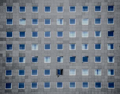 building gray concrete building photography pattern