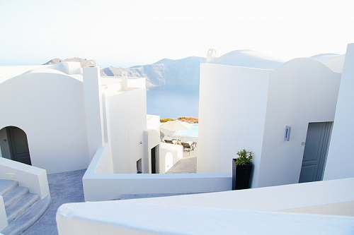 greece landscape photography of white houses interior design