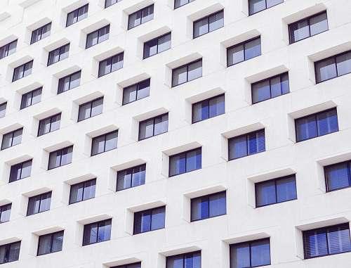 building white concrete building windows